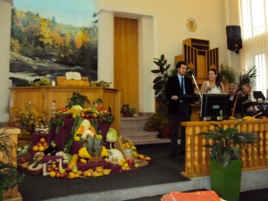 Preaching at Hope Church in R.V. Notice the thanksgiving display setup with great care and then given away after the service.